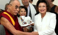 Tibetan spiritual leader the Dalai Lama, left, receives from french member of Parliament Muriel Marland Militello, right, a statue representing a bull in protest of corridas bull fighting, in Toulouse, southwestern France, Monday, Aug. 15, 2011/AP Photo