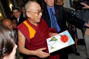 His Holiness the Dalai Lama with Tintin's book of Tibet. Photo: ICT