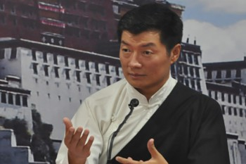 Sikyong gestures while speaking about the need to strengthen women for a collective development of the Tibetan community, at a program organised by TWA, 5 August 2014. (DIIR Photo)