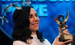 Mercury winner … PJ Harvey picks up the prize for the second time, in 2011. Photograph: Luke MacGregor/Reuters