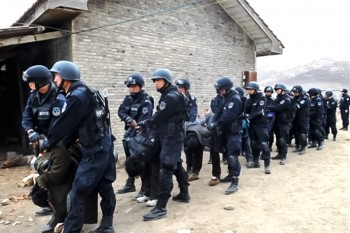 In a crackdown in December 2011, Tibetans are forced to bow down and taken away by heavily armed Chinese military forces. Photo: TPI/Media File