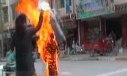 TPI FILE: Graphic image smuggled out of Tibet: November 3rd 2011 – 35 year old Tibetan Nun Palden Choetso set herself on fire protesting against Chinese suppression.