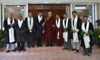 His Holiness the Dalai Lama with members of Kashag and Kashag Secretary Topgyal Tsering Zongkha. From left: Security Kalon Phagpa Tsering Labrang, Education Kalon Ngodup Tsering, Finance Kalon Karma Yeshi, Sikyong Dr Lobsang Sangay, H H the Dalai Lama, Religion Kalon Ven Karma Gelek Yuthok, Home Kalon Sonam Topgyal Khorlatsang, Health Kalon Choekyong Wangchuk and Kashag Secretary Topgyal Tsering Zongkha.