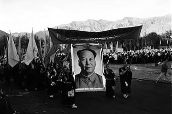 "Two monks with a banner lead a group of monks with a giant portrait of Mao Zedong and flags to celebrate the foundation of the so-called ""Tibet Autonomous Region"" on September 9, 1965. Less than a year later, the monks and nuns became the target of the wrath of violent Red Guards during the Cultural Revolution. Photo: Tibet Museum"