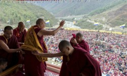 The Dalai Lama waves to supporters after consecrating the Thupsung Dhargyeling Monastery in Dirang, Arunachal Pradesh, on Thursday. Credit: PTI