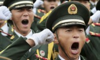 Paramilitary policemen and members of a gun salute team shout slogans at an oath-taking ceremony for the upcoming military parade to mark the 70th anniversary of the end of the World War Two, at a military base in Beijing, China, September 1, 2015. REUTERS/Stringer