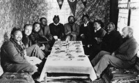 A shot from the Tibetan expedition as the members of the team sit down around a table with locals in a room adorned by a swastika and the SS logo. Photo: File