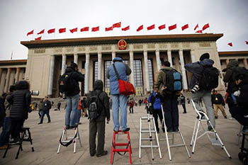 Journalists waiting outside the Great Hall of the People during the Chinese People's Political Consultative Conference in Beijing in March.Credit Kim Kyung-Hoon/Reuters