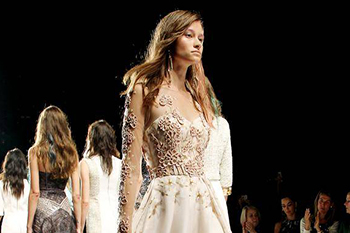 The Badgley Mischka Spring 2015 collection is modeled during Fashion Week in New York on Tuesday. (THE ASSOCIATED PRESS)